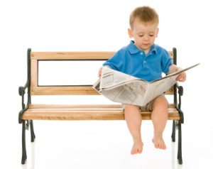 Toddler Reading the Paper